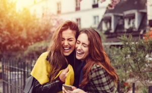 Girls laughing at the street